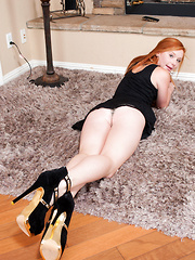 Beautiful redhead Alex Tanner gives a perfect view of her juicy pink twat