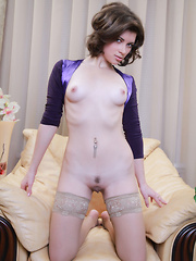 Brunette takes off all the parts of her sexy purple dress that cover up anything of her amazing curves.