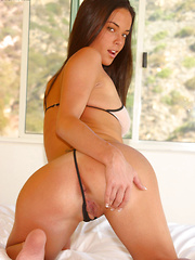 Busty brunette Tylar in sexy, sheer undies spreading her pussy on the bed