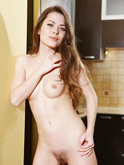 Amelie captures our attention with her sensual, seductive-looking glance, showcasing her stunning naked body