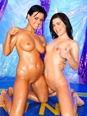 Two sexy teen lesbians massaging their naked moist skin