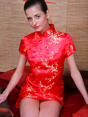 Irina B exudes a sultry doll dressed in a bright red cheongsam.