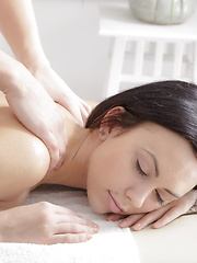 Masseur pleases his beautiful client on the massage table