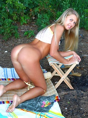 She is in the woods to try out her new pink vibrator there