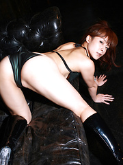 Rika Kawamura Asian in boots shows naughty behind in nylon outfit