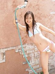 Rola Chen Asian plays with outdoor shower on body over lingerie